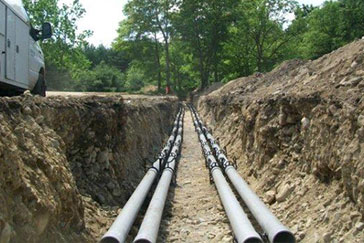 Electrical conduit in trench for cell site