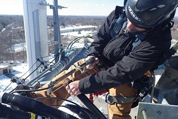 RF mechanic working on cell tower